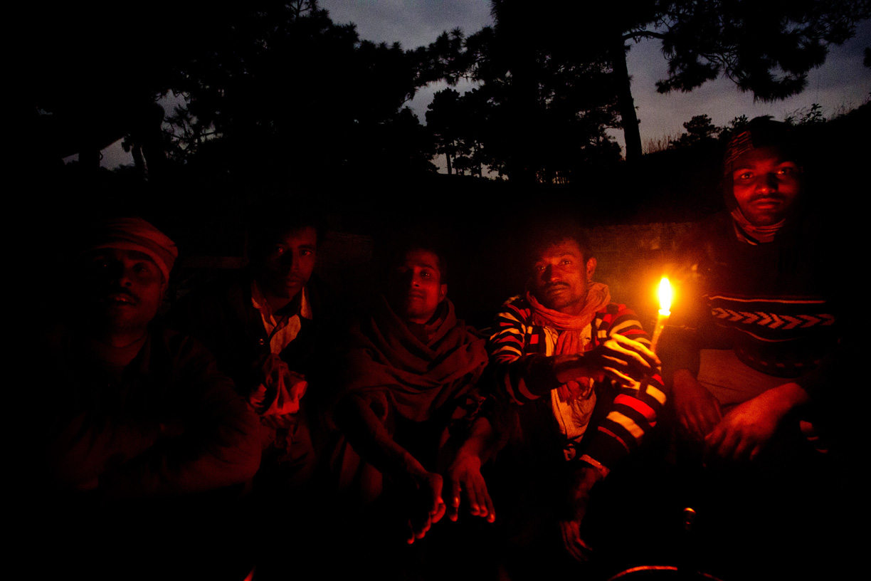 Coal miners pose for a portrait at their camp in the Jaintia HIlls.