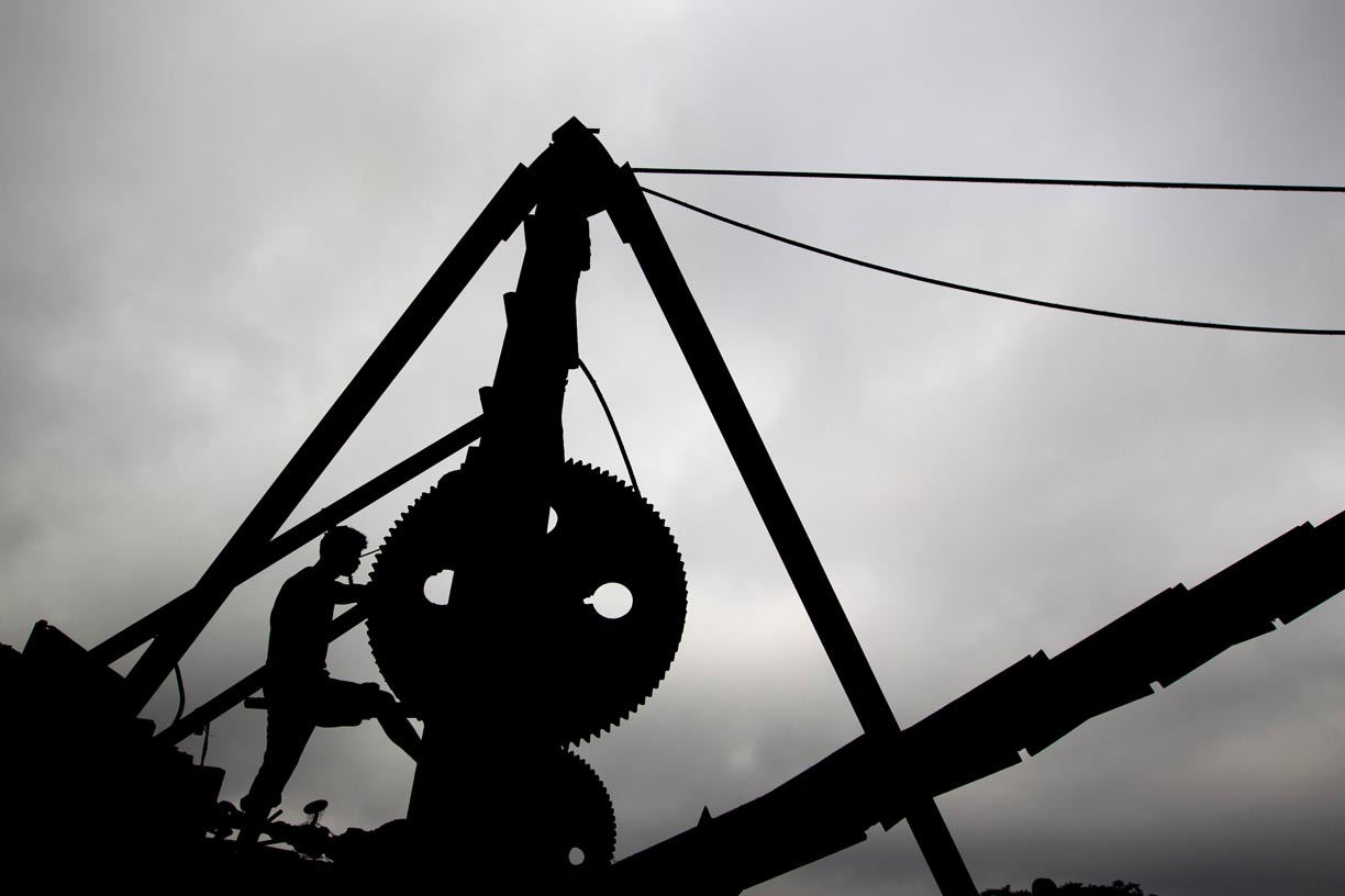 A machine operator oversees a load of coal being lifted to the surface in the Jaintia Hills.