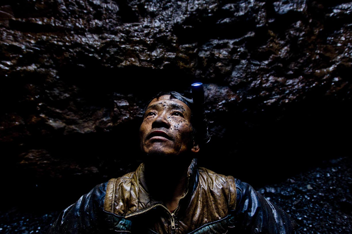 A miner takes a break inside a pit in the Jaintia Hills.