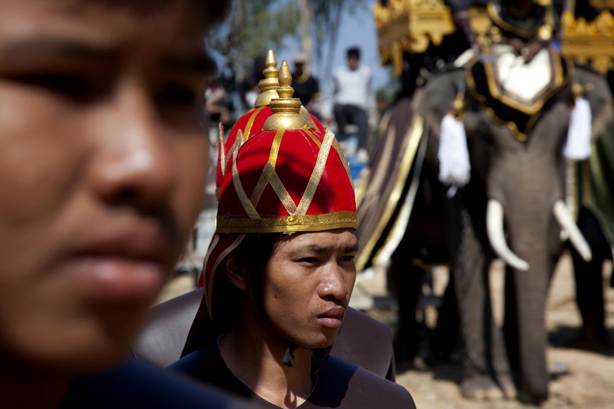 Mahouts and elephants wait backstage to perform at the Surin Elephant Roundup.