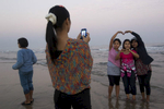 Tourists from Yangon pose for a photo in Chaung Tha.