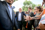 Senator Bernie Sanders greets the crowd of supporters as he arrives at the MPR News booth at the Minnesota State Fair on August 24, 2019.