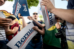 Bernie Sanders supporters pass out posters before his arrival at the MPR Booth at the Minnesota State Fair in St. Paul, MN on August 24, 2019.