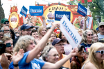 The crowd cheers for Senator Bernie Sanders at the MPR News booth at the Minnesota State Fair in St. Paul, MN on August 24, 2019.
