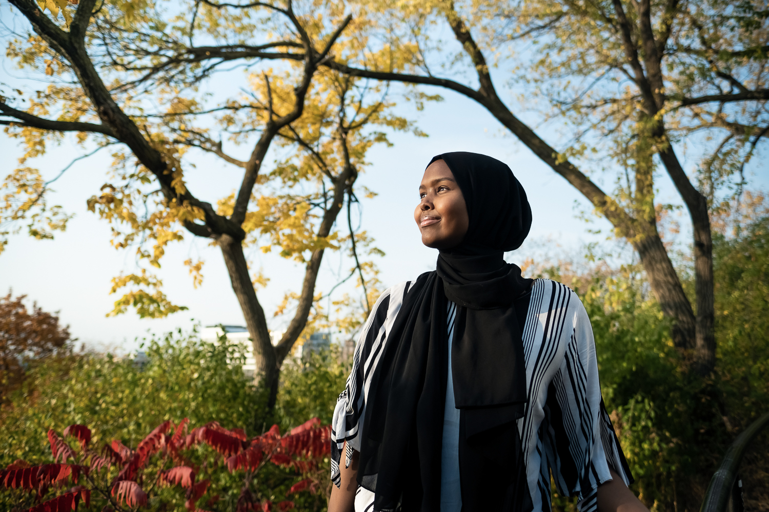 Rahma Farah, 17, of St. Paul, MN, poses for a portrait at a park hear her home on October 9, 2020. On election day this November Farah will  be working at a polling station as a supervisor helping to  register first time voters. She also helps translate election  instructions into Somali.