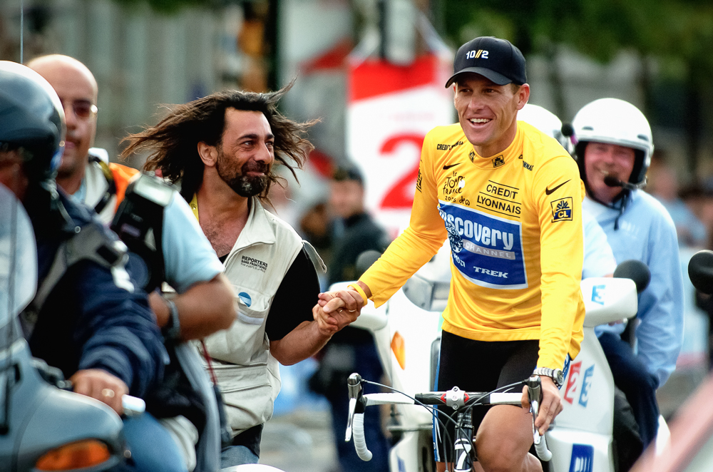 2005 STAGE 20 / Paris, France: Lance Armstrong receives a heartfelt congratulations at the end of the 2005 Tour de France. Armstrong retired at the completion of the Tour, but returned in 2009.