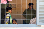 A young boy peers out of an examination room at the Konsath Health Center in southern Cambodia.