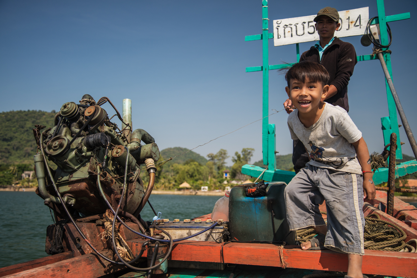 An excited young deckhand jumps around on his family's fishing boat.