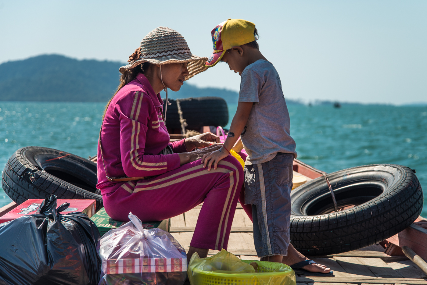 This family uses their fishing vessel to ferry visitors and supplies from the town of Kep to islands of the coast of southern Cambodia.