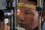 This man's lenses are being checked for any signs of cataracts.  A cataract is the clouding of the eye's natural lens.