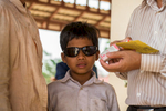 This young boy, Trean Ya, just received a cataract surgery after being blind in one eye for two years.  His mother and the doctor discuss the medication Trean will need during his recovery period.