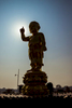 A statue of the Buddha and his glowing hand.