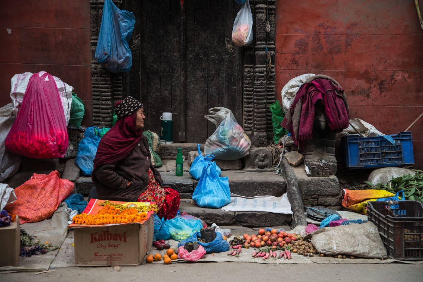 A woman sells her wares on the side of the street in Nepal's capital, Kathmandu.