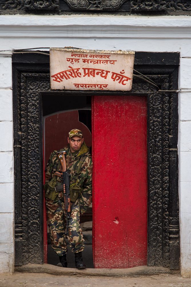 A soldier guards an entrance to a government building in Durbar Square in Kathmandu.