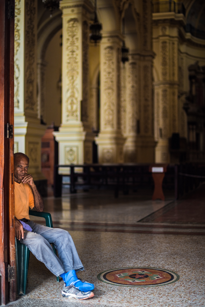 This faithful doorman sits in the entrance of a Catholic Church in Old Havana.