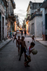 Groups of kids play in the streets of Old Havana at dusk.  It was 26 de Julio, a national holiday in Cuba and the streets were bustling all over the city.