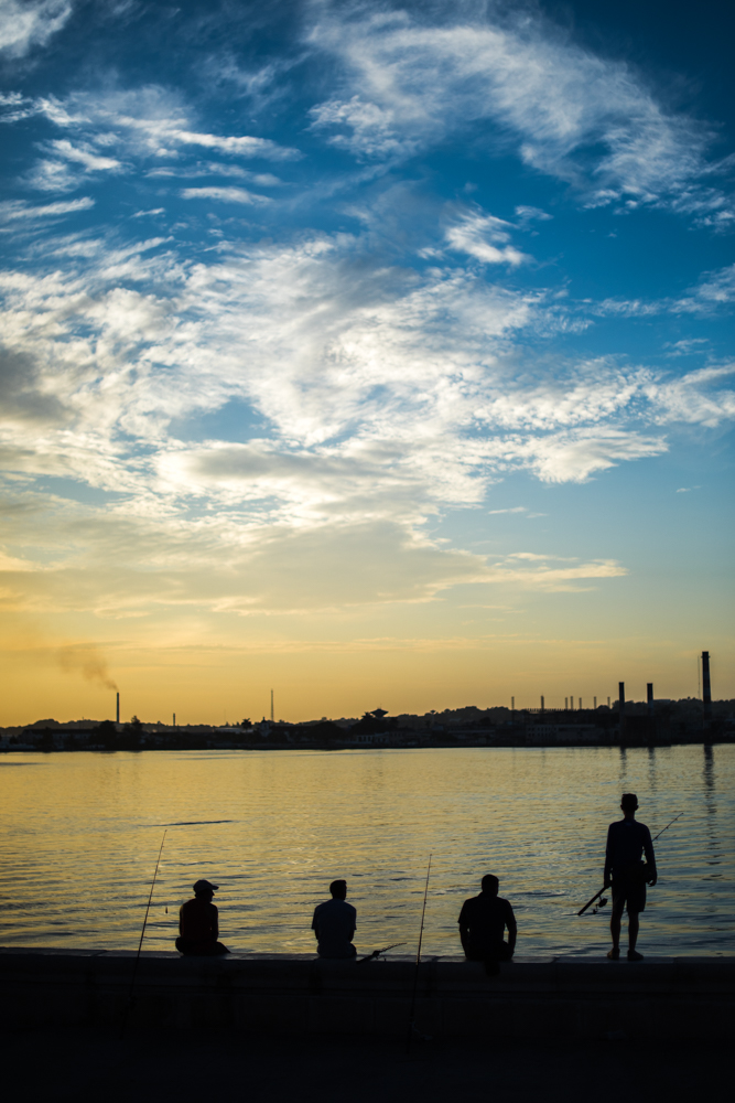 These young fishermen meet on the edge of the Havana harbor at dawn.  This heavily polluted harbor still contains a variety of different fish.