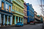 Colorful buildings line the street in Centro Habana.  The blue building is one of H. Upmann, the popular cigar maker's factories.