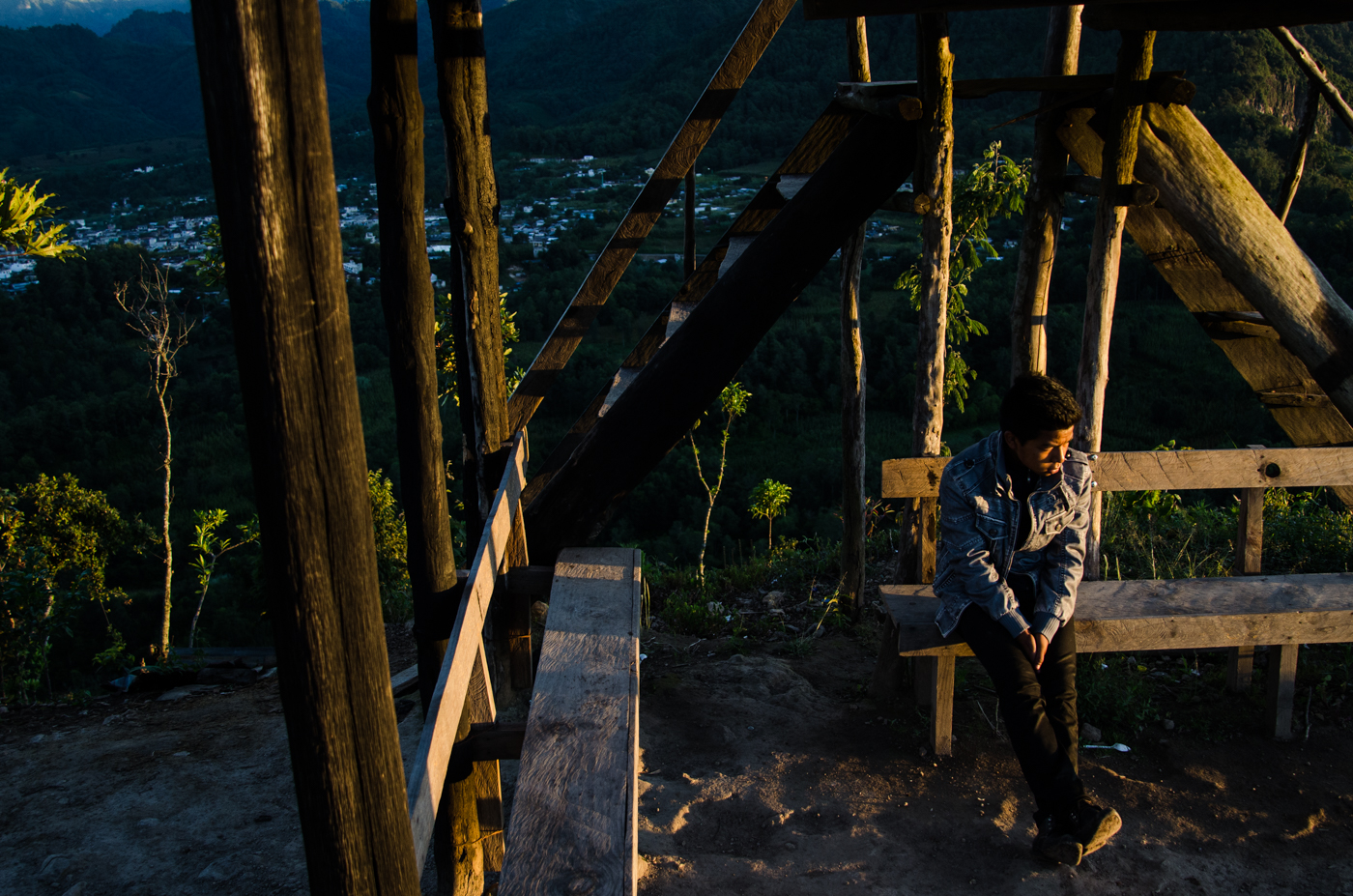A guide sits under the watch tower at the top of La Nariz de Indio, a mountain on the shores of Lake Atitlán.