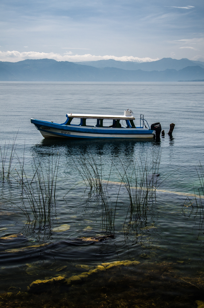 A boat sits anchored in the shallows of San Pablo.