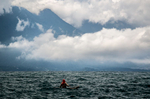 A fisherman works on the choppy afternoon waters of Lake Atitlán.