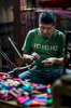 A textile craftsman prepares thread at a workshop in the Guatemalan Highlands.