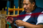 Camarón has been weaving in several methods for his entire life.  He now runs a small workshop out of his home, where his whole family and some employees work.