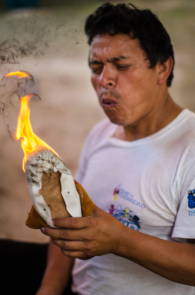 Leonel blows out the flame once the toe has finished hardening.