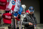 A man selling his Trump wares in downtown D.C. inspects one of his pins.