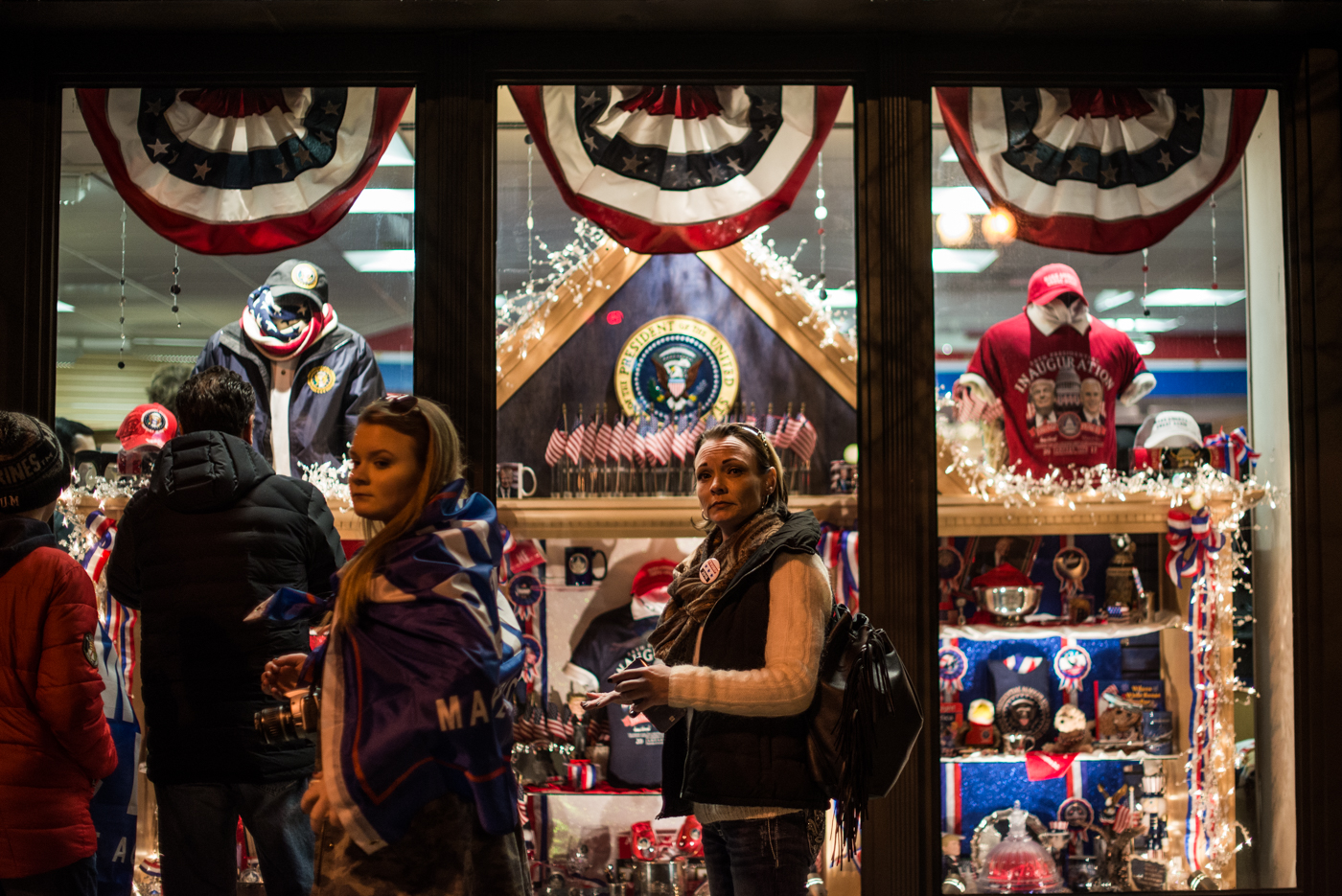 Fans window shop for Inauguration 2017 gear in downtown DC.