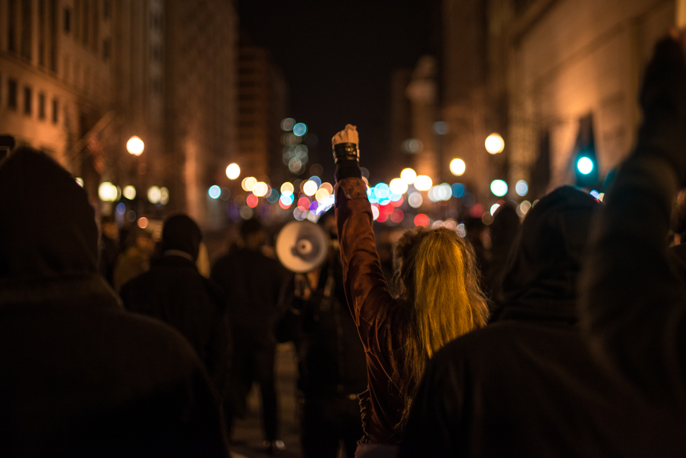 A woman raises her fist during a march in the streets of downtown Washington, D.C.