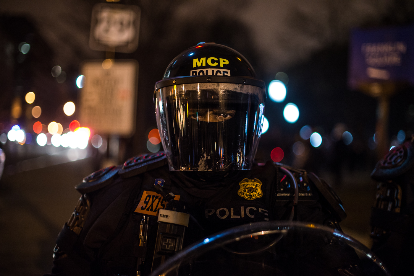 A police officer in full riot gear at Franklin Square.