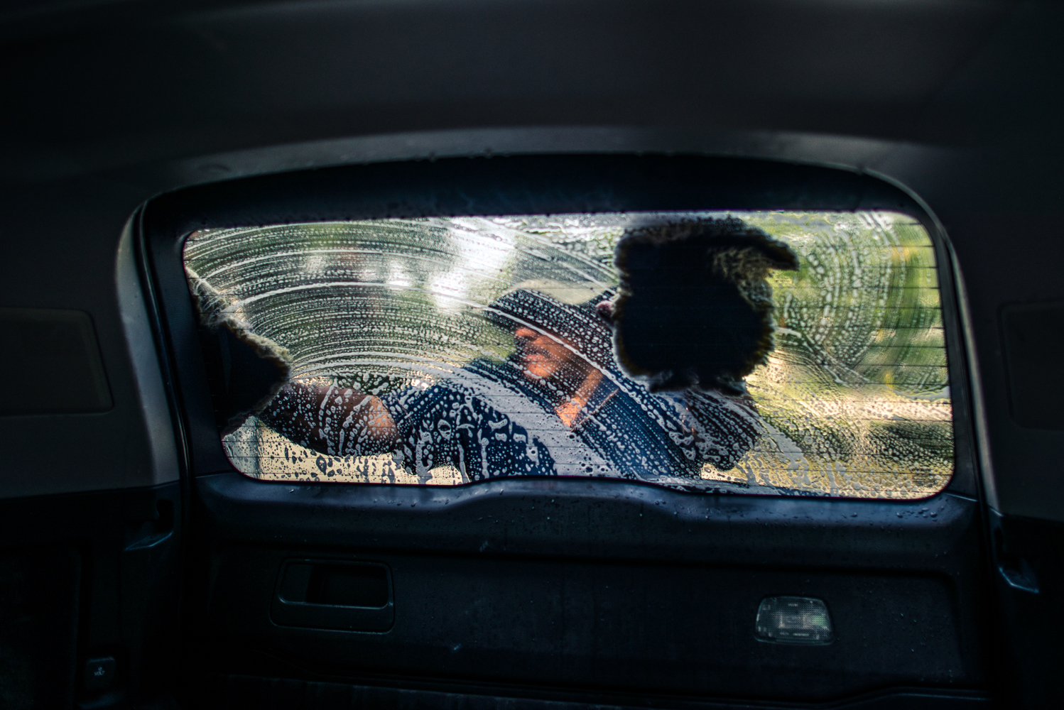 Durham, North Carolina, 2018José washes cars in the church parking lot make money to support himself and his family.  The financial burden of having a family member ins sanctuary is significant.