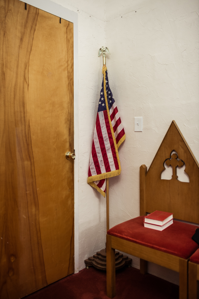 Greensboro, North Carolina, 2018Politics are never far away. This flag is tucked in the corner of the sanctuary at the church where Juana is in refuge.