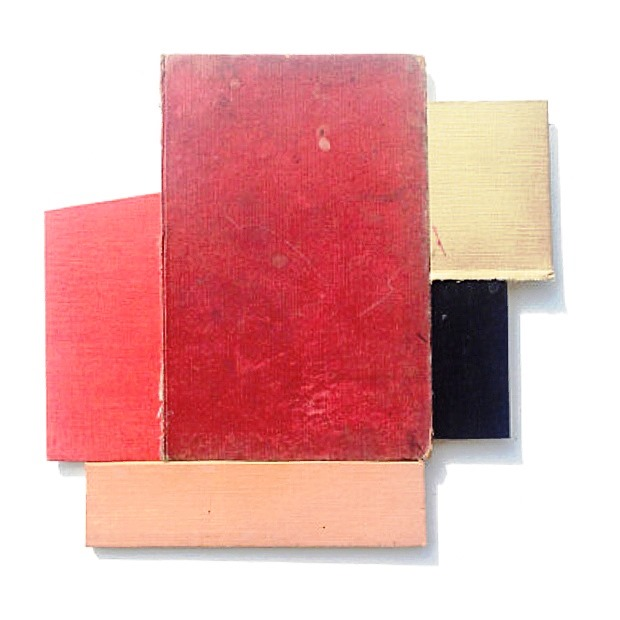unframed constructs book covers on birch ply wood
