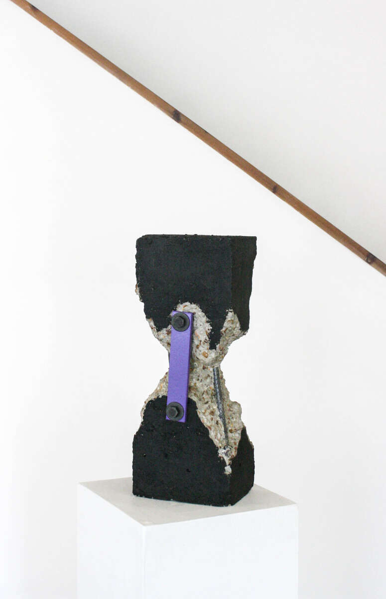 Trustin (2019) Carved concrete, steel, tar, paint, 20 x 8 x 6 in.