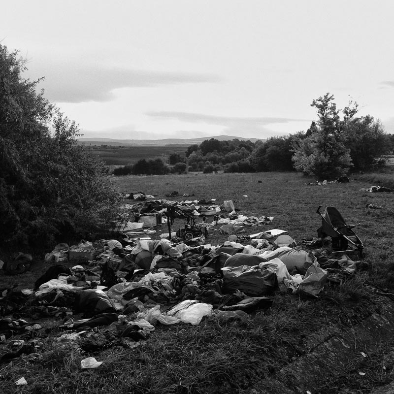 sept. 6, 2015. discarded clothes and other items stand by the side of a highway, tatabanya, hungary.