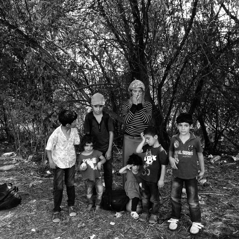 sept. 3, 2015. an iraqi kurdish mother pauses with her children as she crossed serbia's border with hungary, roszke, hungary.