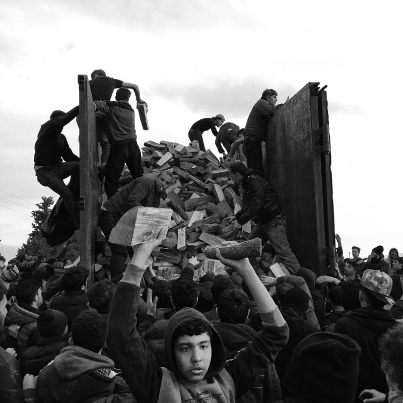 march 6, 2016. distribution of firewood, idomeni refugee camp, greece.