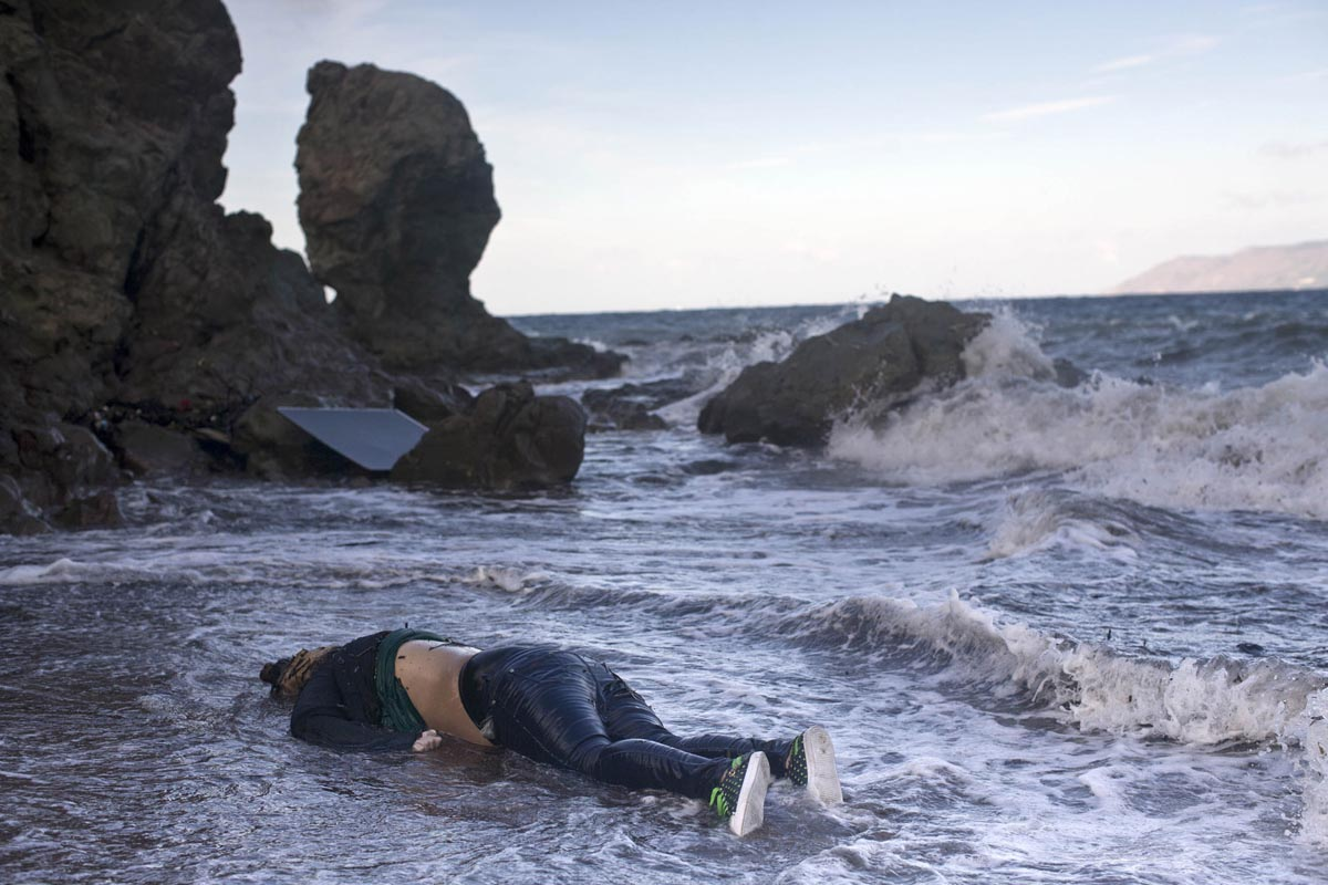 A body of a woman that had died when her boat sank is washed ashore, Lesbos, Greece, Nov. 1, 2015.