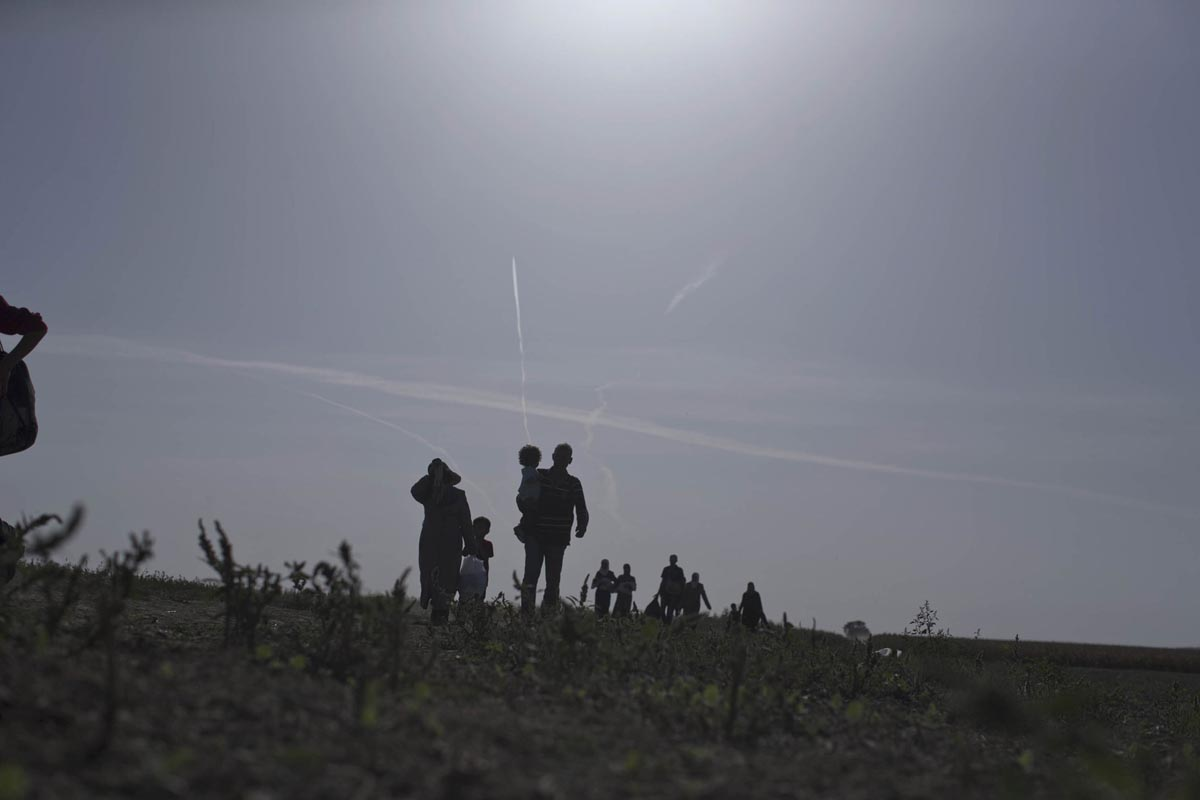 migrants and refugees walk towards serbia's border with croatia, sid, serbia, sept. 18, 2015.