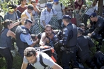 People break through a police line as a crowd of refugees converges on a train station, Tovarnik, Croatia, Sept. 17, 2015.