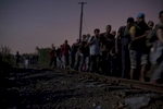 A group of refugees crosses the Serbian-Hungarian border at night, Roszke, Hungary, August 29, 2015.