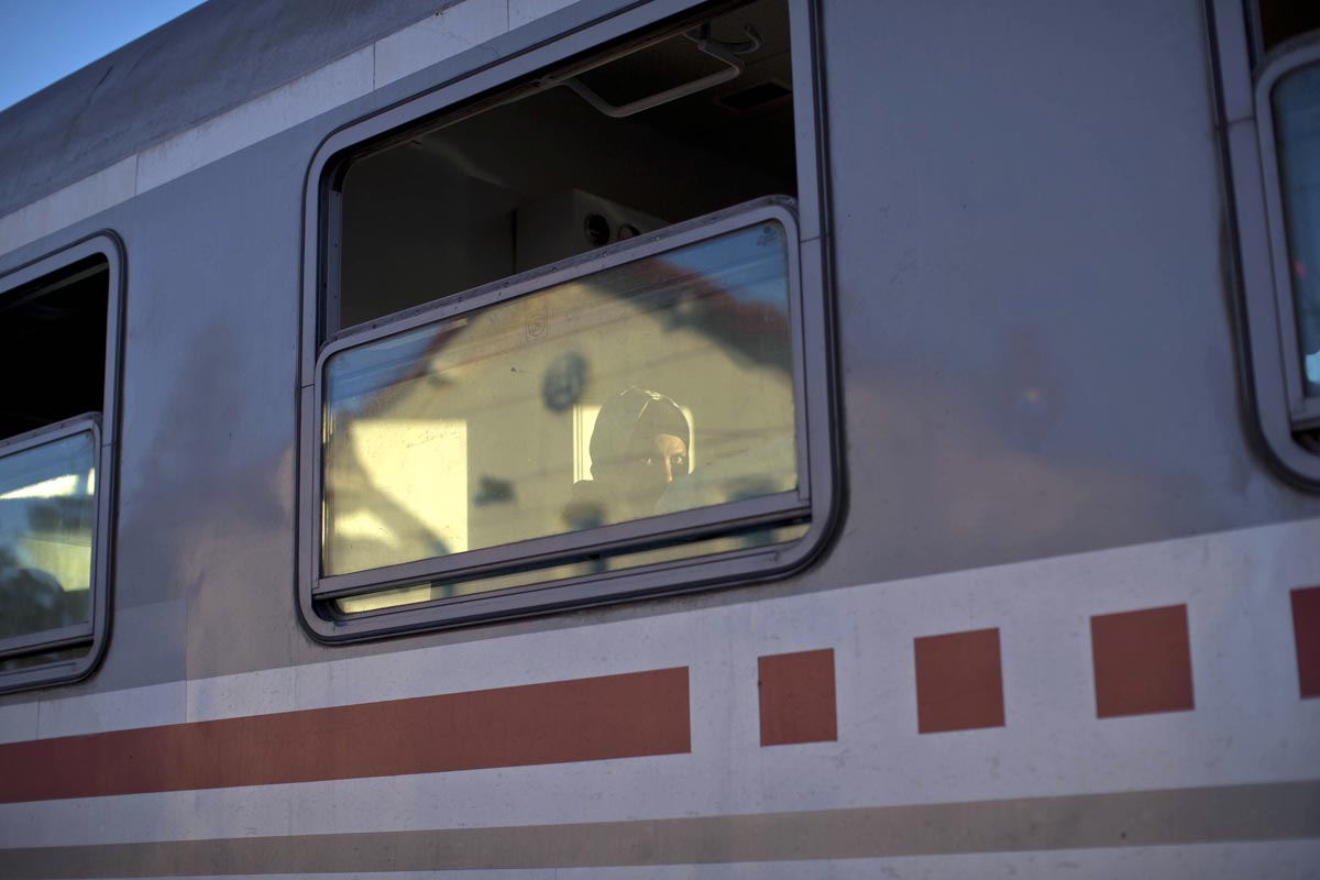 a woman sits inside a train that would take her towards slovenia, tovarnik, croatia, sept. 21, 2015.