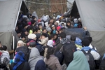 People crowd a tent as they attempt to cross Serbia's border with Croatia, Berkasovo, Serbia, Oct. 24, 2015.