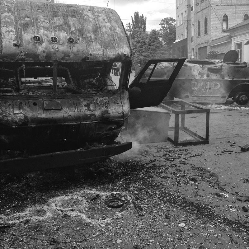 june 13, 2014. the aftermath of a firefight, mariupol, ukraine. big checkpoint. a. asks the ukrainian soldiers to search reuters' car so they lose time.