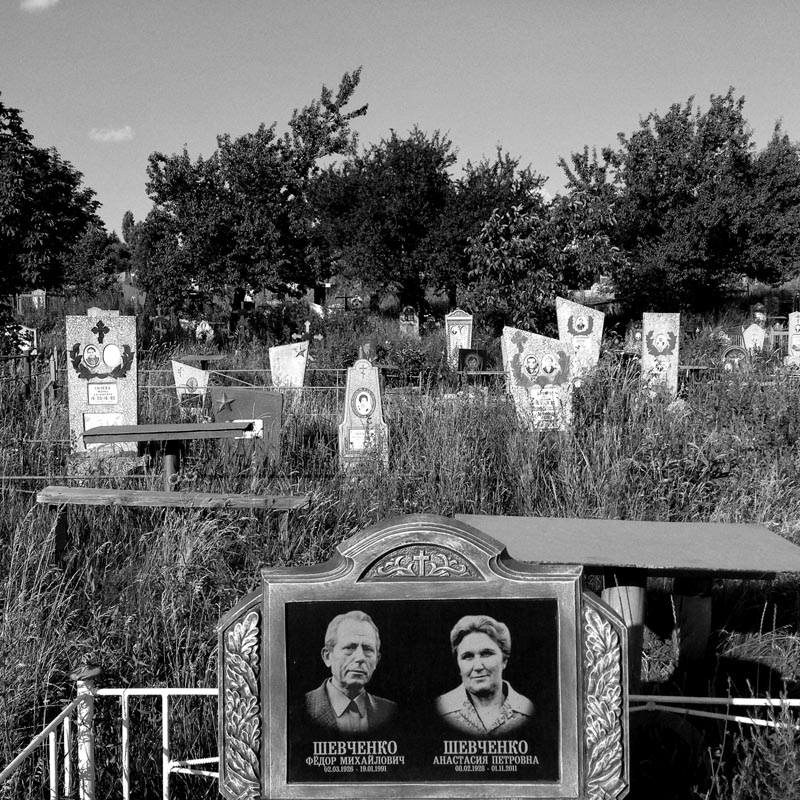 june 16, 2014. a cemetery, artemivsk, ukraine. nom de guerre alyosha chooses to get into our minivan in broad daylight, while people around. wants us to go film ukrainian positions around the border and come back to show him the footage. i ask a. to explain to him we won't do that. he seems to understand. we go back to donetsk. no story today.