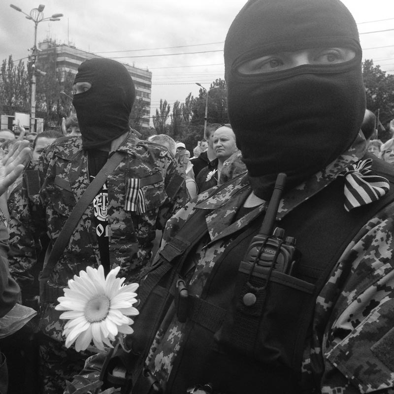 June 21, 2014. Members of a pro-Russian militia, Donetsk, Ukraine. M. films today. He points his camera at armed guys driving an old Mercedes, Donetsk license plates. I knew it was trouble. A guy steps up to him, asking to see the footage. M. is courteous, but this guy doesn't understand courtesy.