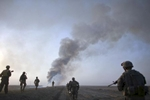 u.s. army soldiers from fox troop, sabre squadron, 3rd armored cavalry regiment, move in formation after they set a deserted village on fire, outskirts of balad ruz, diyala province, iraq, 2008.
