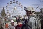 a u.s. army soldier from warrior battery, 2nd battalion, 82nd field artillery regiment, patrols an amusement park, mosul, iraq, 2009.